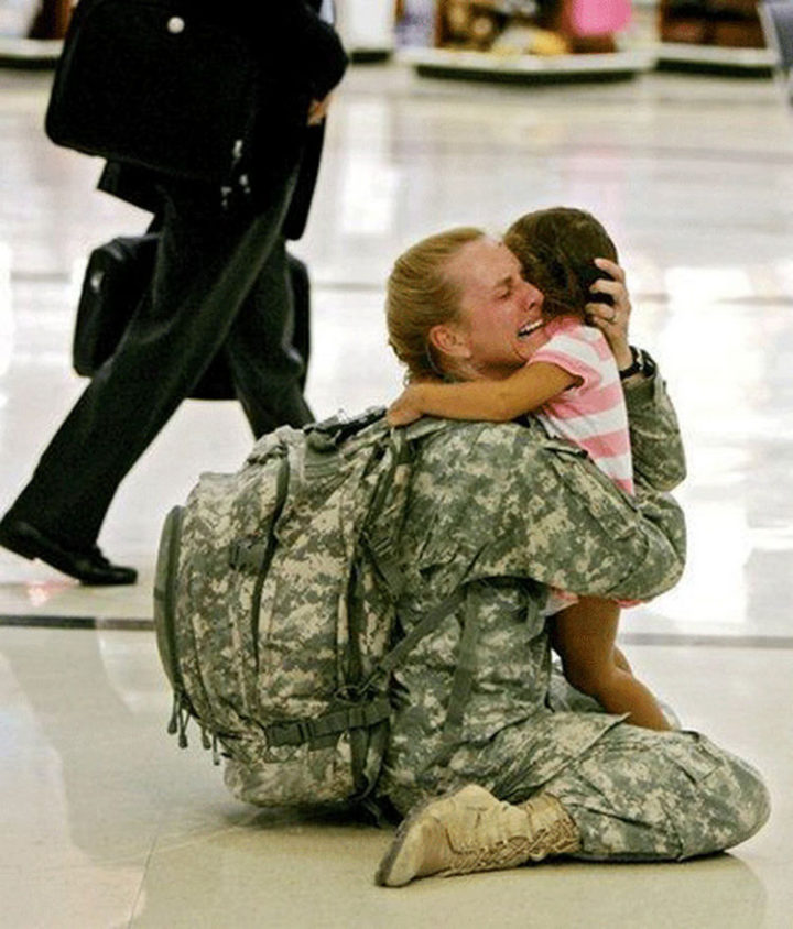 15 Emotional Photos of Soldiers Coming Home - A mother hugging her daughter after an emotional return.