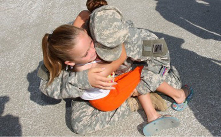 15 Emotional Photos of Soldiers Coming Home - A beautiful family reunited after a tour of duty.
