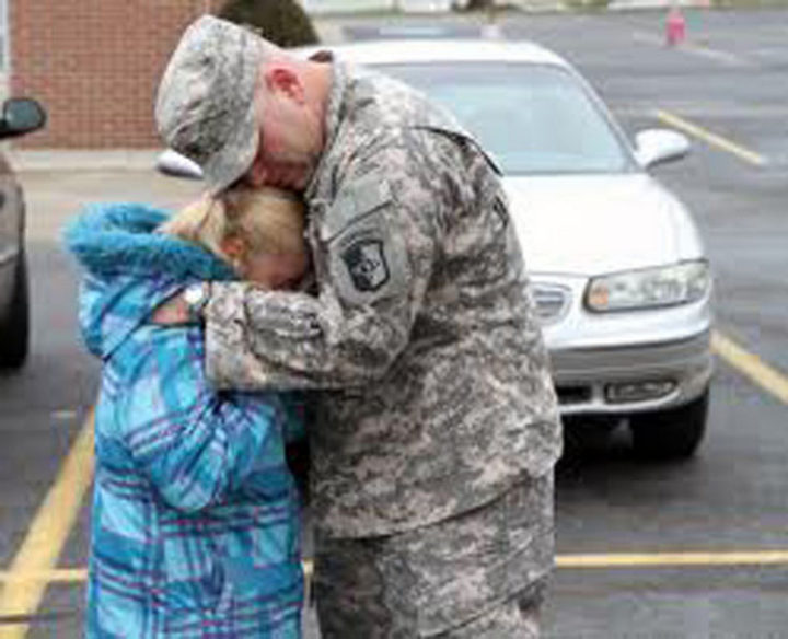15 Emotional Photos of Soldiers Coming Home - An emotionalfather and daughter thankful to be together again.
