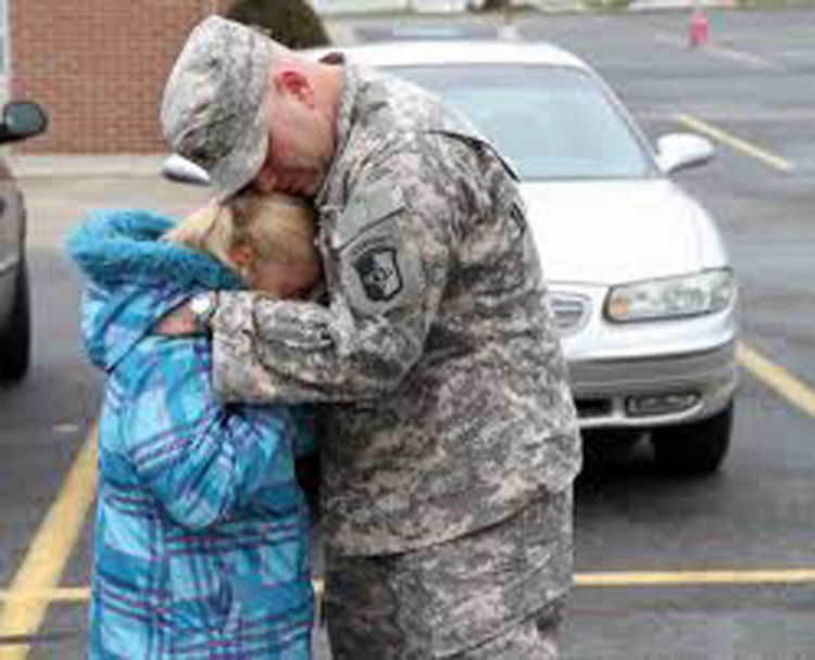 15 Emotional Photos of Soldiers Coming Home - An emotional father and daughter thankful to be together again.