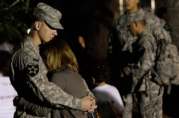 15 Emotional Photos of Soldiers Coming Home - A soldier hugging his girlfriend after a tour in Iraq.