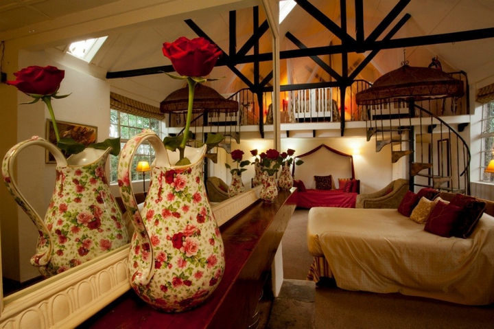 Giraffe Manor has 10 beautiful rooms that offer spacious accommodations with high-vaulted ceilings.