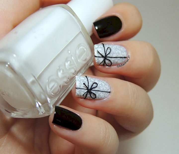 14) This bow nail art design uses real thread to create a bow and the  effect is jaw-dropping. - 17 Bow Nail Art Designs That Are Too Adorable Not To Try