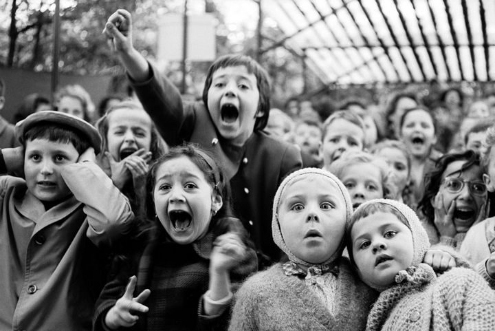 """22 Timeless Images - Children watch in amazement as the story of """"Saint George and the Dragon"""" is performed at an outdoor puppet theater in Paris (1963)."""