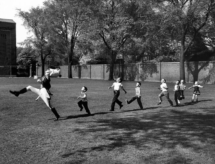 22 Timeless Images - A University of Michigan drum major leads a group of children in Ann Arbor, Michigan (1950).