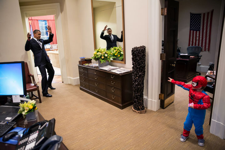 22 Timeless Images - U.S. President Barack Obama meets with a little boy dressed as Spider-Man for Halloween (2012).