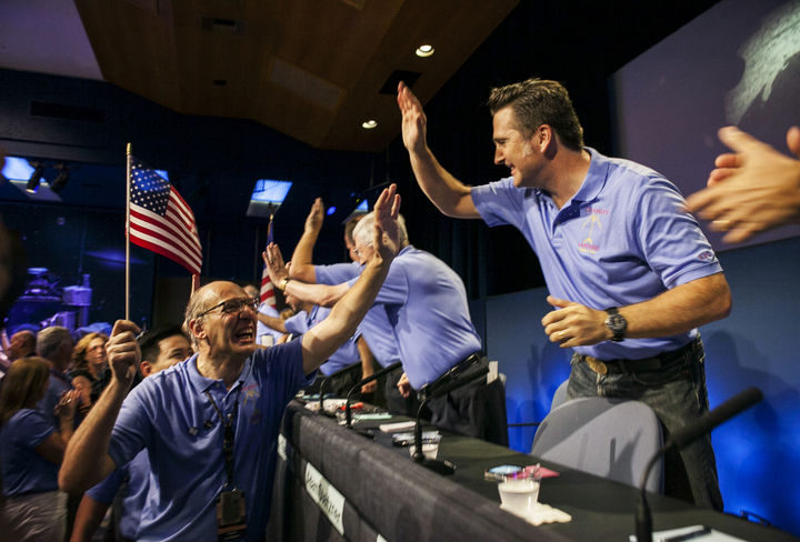 22 Timeless Images - NASA engineers at NASA's Jet Propulsion Laboratory celebrating the successful landing of Curiosity rover on the surface of Mars (2012).