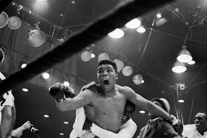 22 Timeless Images - Cassius Clay defeats Sonny Liston for the heavyweight boxing title (1964).