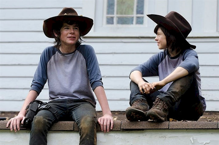 """23 Celebrities Hanging Out With Their Stunt Doubles - Chandler Riggs and his stunt double on the set of AMC's """"The Walking Dead."""""""