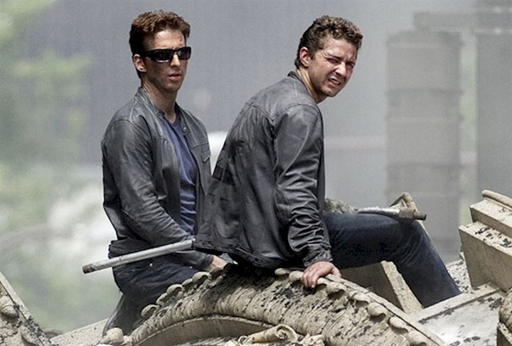 """23 Celebrities Hanging Out With Their Stunt Doubles - Shia LaBeouf with his stunt double on the set of """"Transformers."""""""