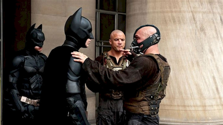 "23 Celebrities Hanging Out With Their Stunt Doubles - Christian Bale and Tom Hardy go through a scene with their respective stunt doubles on the set of ""The Dark Knight Rises."""