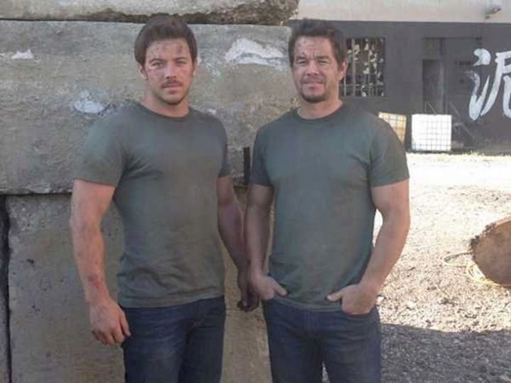 """23 Celebrities Hanging Out With Their Stunt Doubles - Mark Wahlberg and his stunt double hanging out of the set of """"Transformers: Age of Extinction."""""""