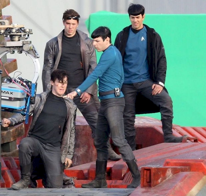 """23 Celebrities Hanging Out With Their Stunt Doubles - Benedict Cumberbatch and Zachary Quinto rehearse a fight scene with their respective stunt doubles on the set of """"Star Trek Into Darkness."""""""