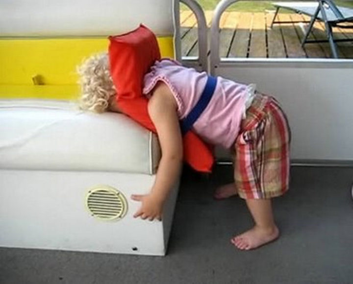 25 Kids Sleeping in the Strangest Places - So much for a scenic boat ride.