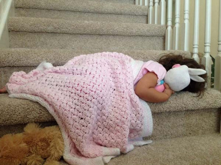 25 Kids Sleeping in the Strangest Places - She adorably couldn't make it all the way up the stairs to her bed.