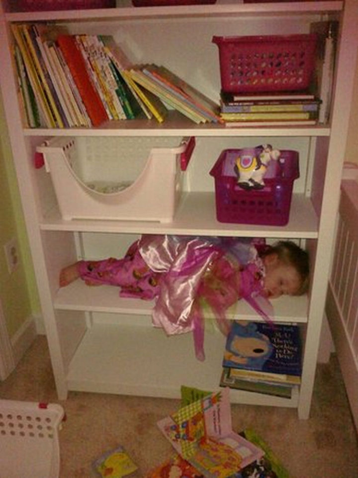 25 Kids Sleeping in the Strangest Places - This shelf is just her size.