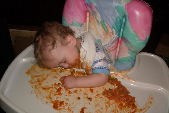 25 Kids Sleeping in the Strangest Places - Napping after too many carbs.