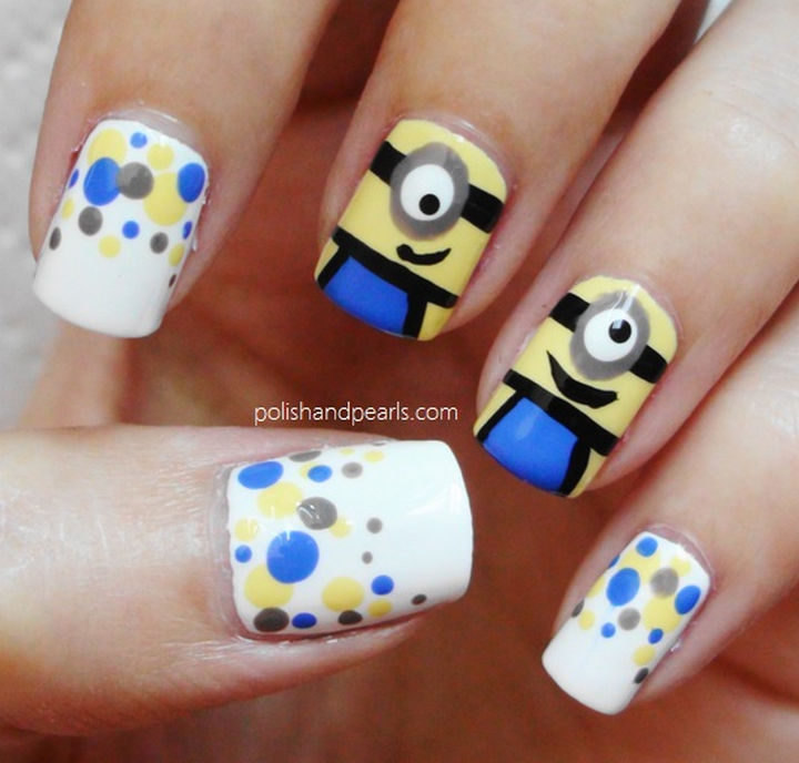 16) Minion nail art accent nails. - 19 Minion Nails That Are Adorable. Go Bananas With Minion Nail Art!