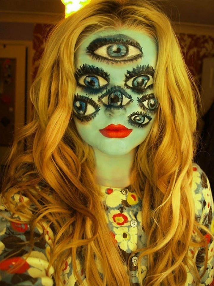 37 Scary Face Halloween Makeup Ideas - The girl with many eyes.