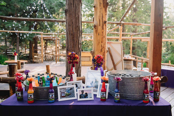 Also, nearly everything is handmade including wedding invitations, flower arrangements in Jones cola bottles, and even custom centerpieces made from clay.