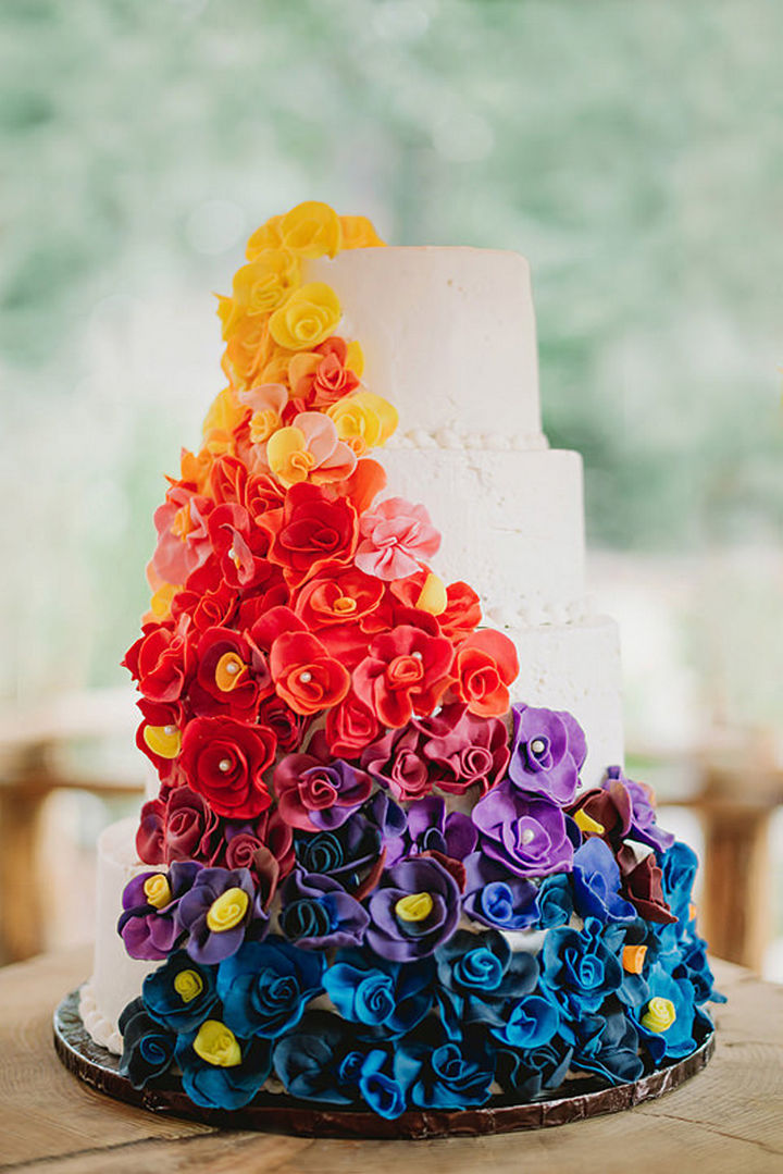 You didn't think we'd forget the cake did you? The wedding cake with colorful cascading flowers is just as breathtaking as the wedding dress.