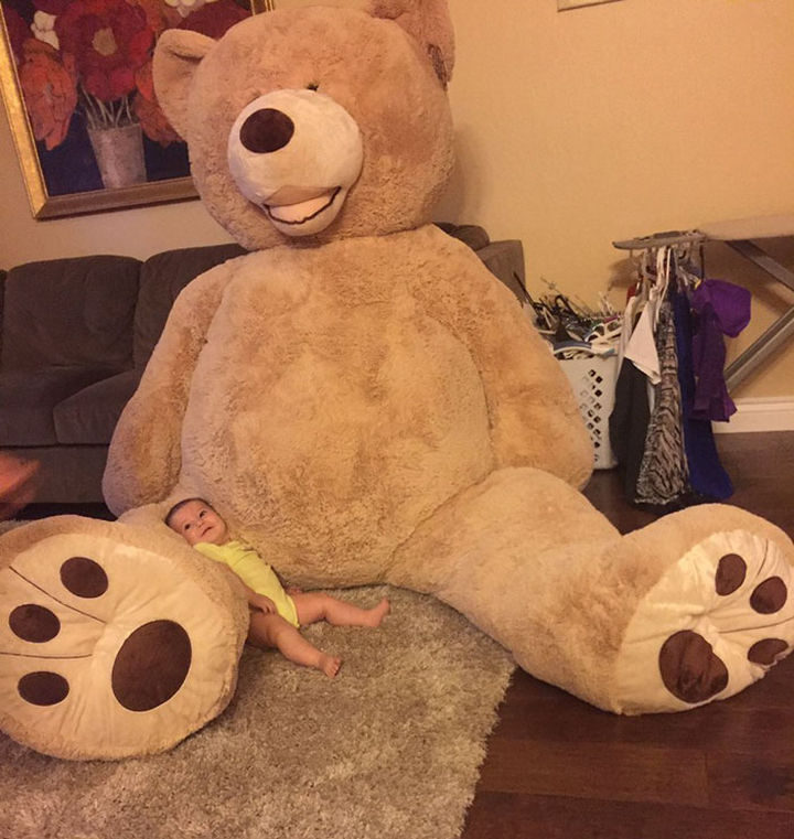 Her teddy bear is really, really huge but it's her new best friend. Look at that smile!