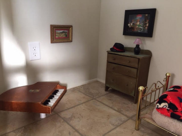Everything is tiny and adorable. A tiny piano, dresser, rugs, and even a tiny lamp.
