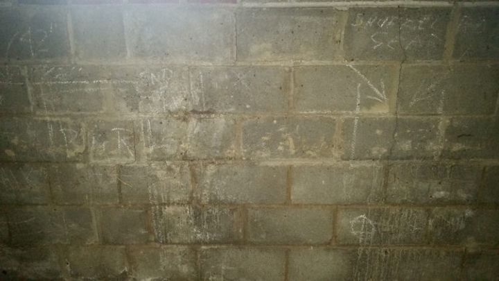 A man decided to remodel his basement and began by removing the walls and found some random drawings.