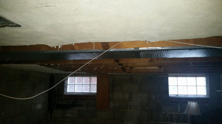 With the walls removed, the next step is to remove the ceiling which had nearly 1/4 inch of dust trapped within.