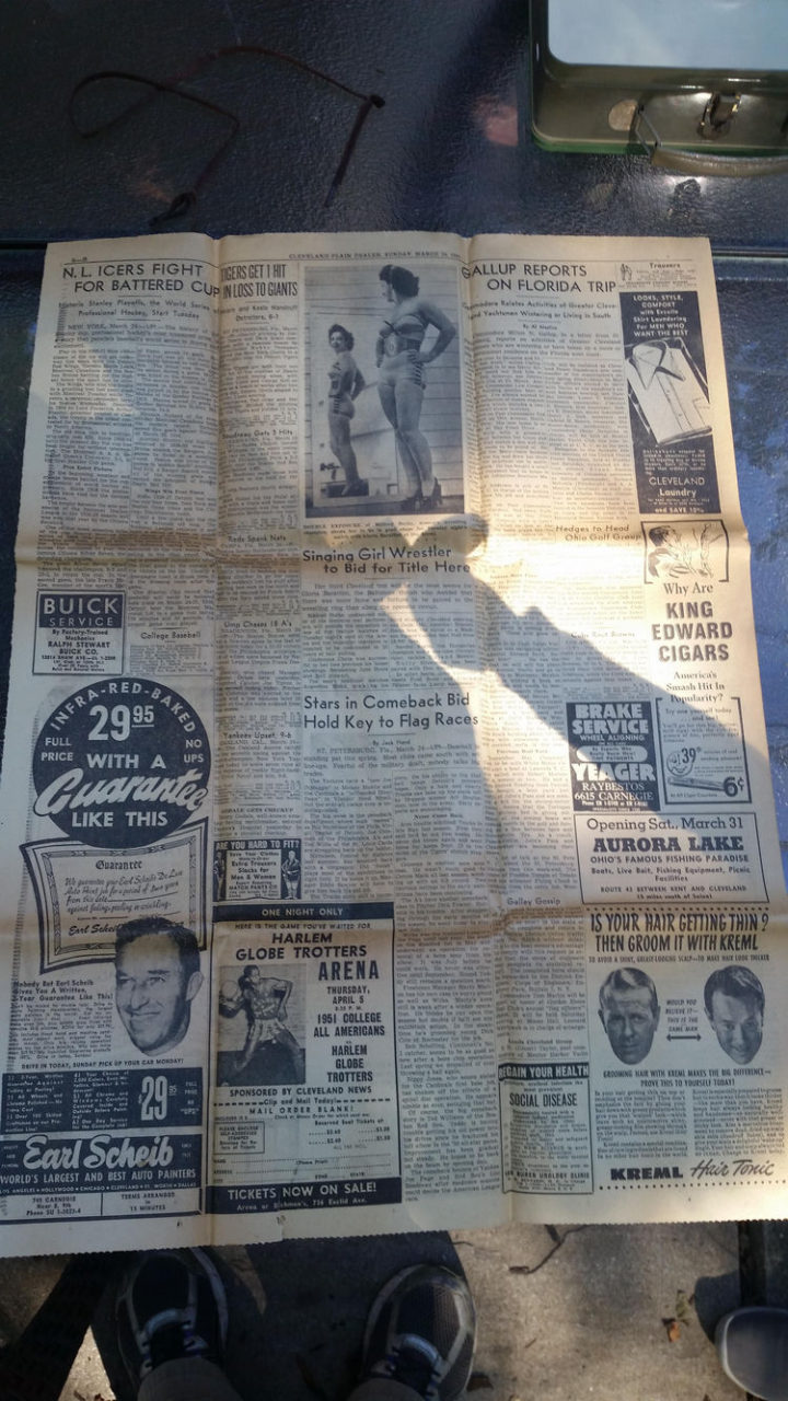 After removing the wax paper, he found old newspaper clippings lining the bottom of the box.