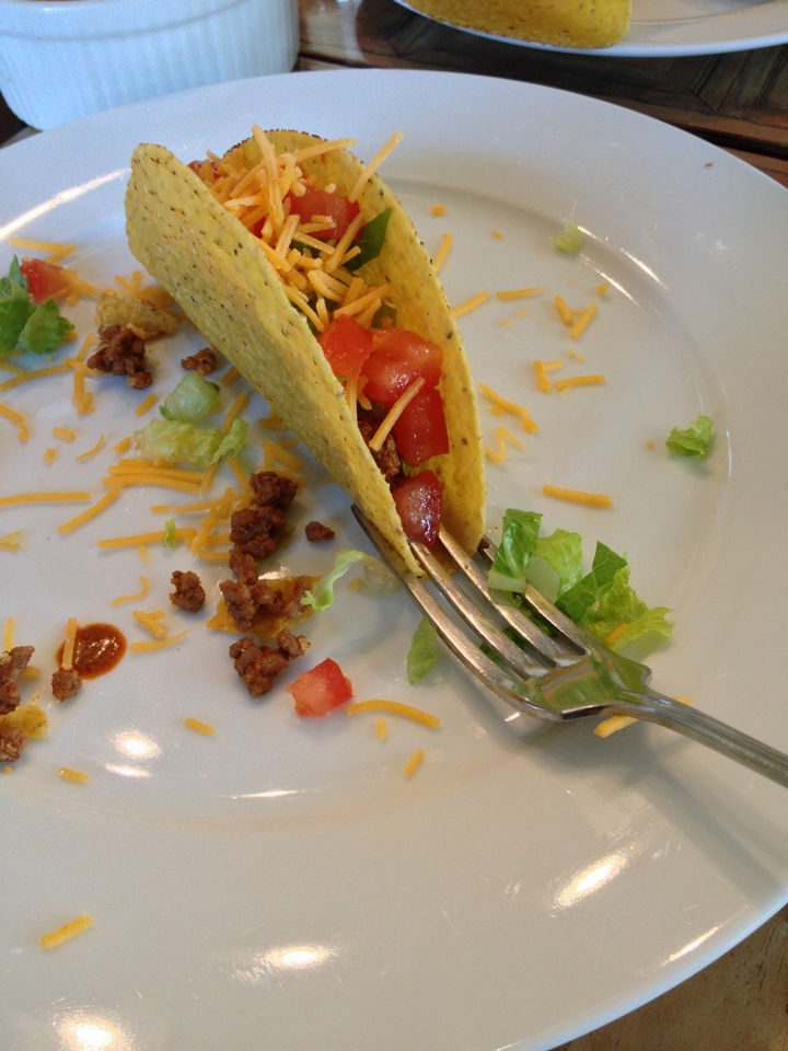 21 Everyday Life Hacks - Use a fork to prevent your taco from falling over when loading it.