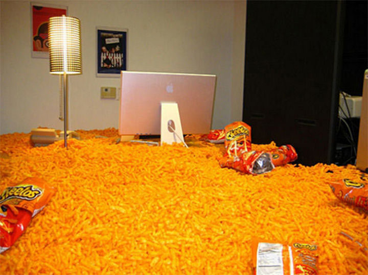 26 Funny Office Pranks - Who's in the mood for Cheetos?
