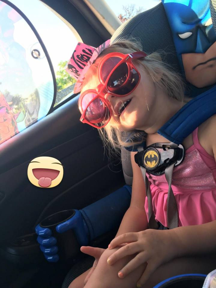 While Supergirl and Spider-Man are her favorites, she loves them all including her Batman car seat!