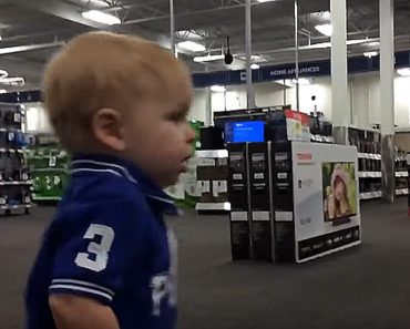 Little Boy Lands the Cutest First Kiss Ever While Shopping With His Dad.