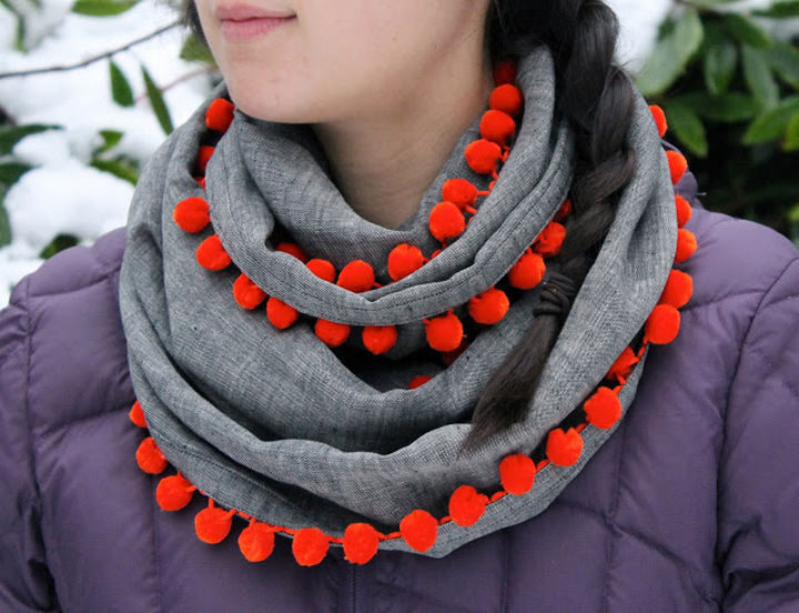 18 DIY Winter Clothes and Accessories - Make a pom-pom infinity scarf.