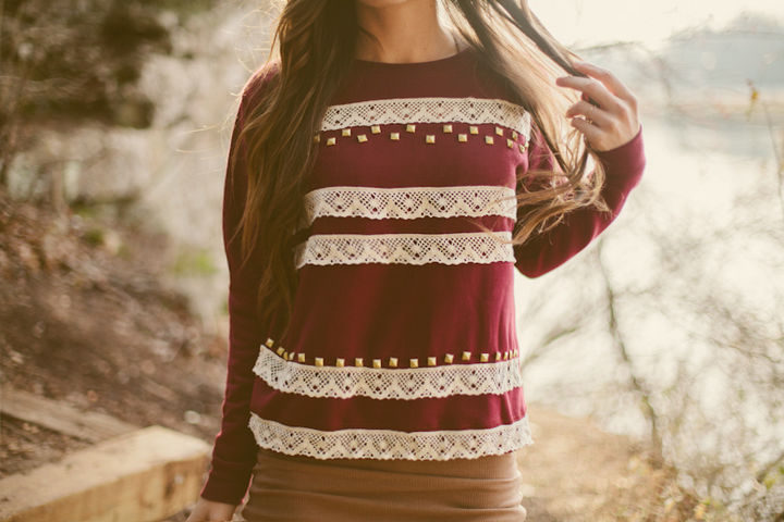18 DIY Winter Clothes and Accessories - Give some festive flair to a sweatshirt with lace and studs.