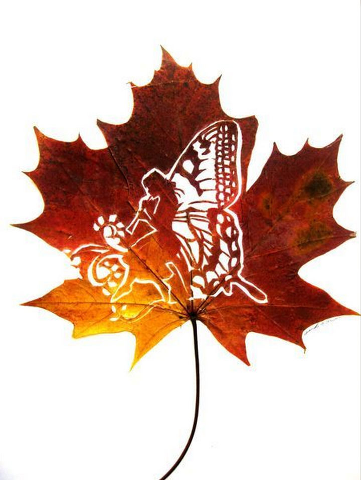 Colors dance in this leaf carving of a whimsical fairy playing a flute.