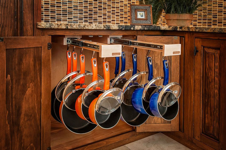 18 DIY Storage Ideas For Your Home - Store your pans on slide-out racks for easy access.