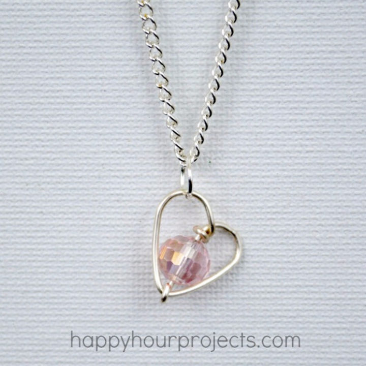 27 DIY Valentine's Day Crafts - Create a handmade DIY wire-wrapped heart necklace.