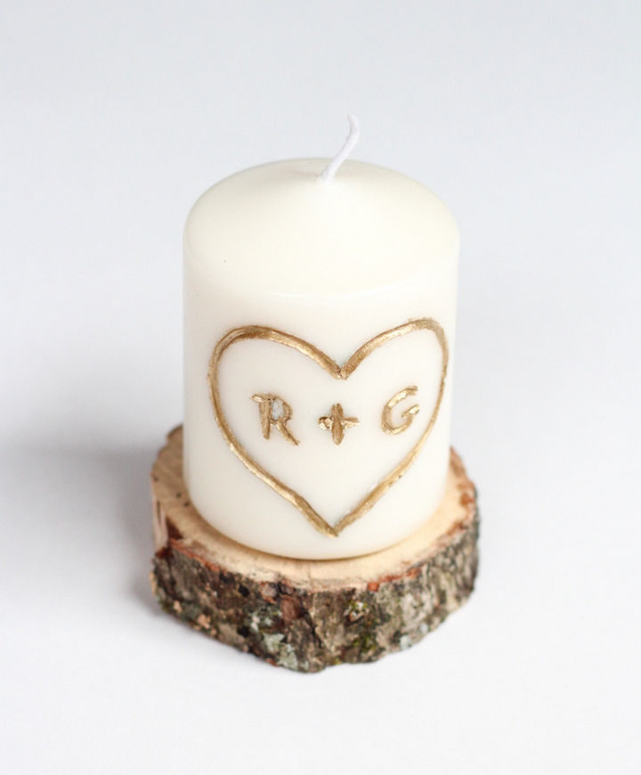 27 DIY Valentine's Day Crafts - DIY candle with carved initials.