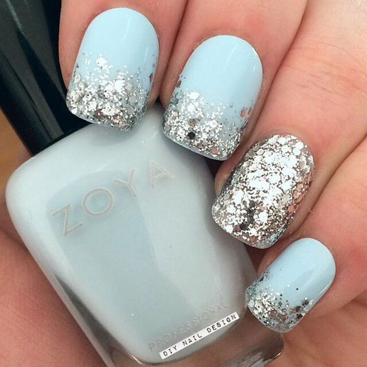 17 Winter Nails - Silver glitter with a striking accent nail.