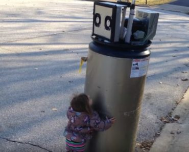 "Little Girl Rayna Meets Her First Water Heater ""Robot."""