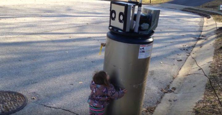 "Little Girl Rayna Meets Her First Water Heater ""Robot."""
