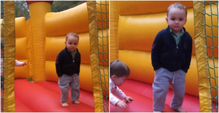 Cool 2-Year-Old in Bounce House With Hands in His Pocket.