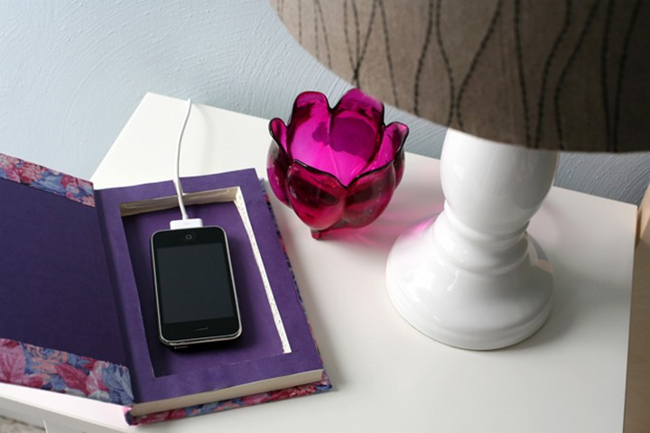 11 Creative Ways to Hide TV Wires - Create a DIY book phone charger.