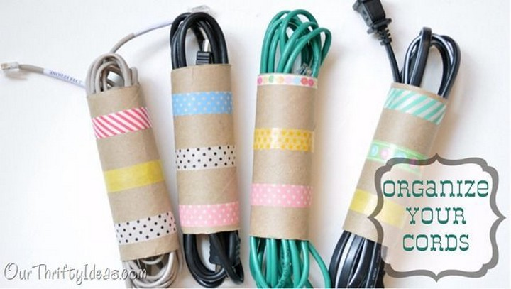 11 Creative Ways to Hide TV Wires - Organize your cords with toilet paper rolls and washi tape.
