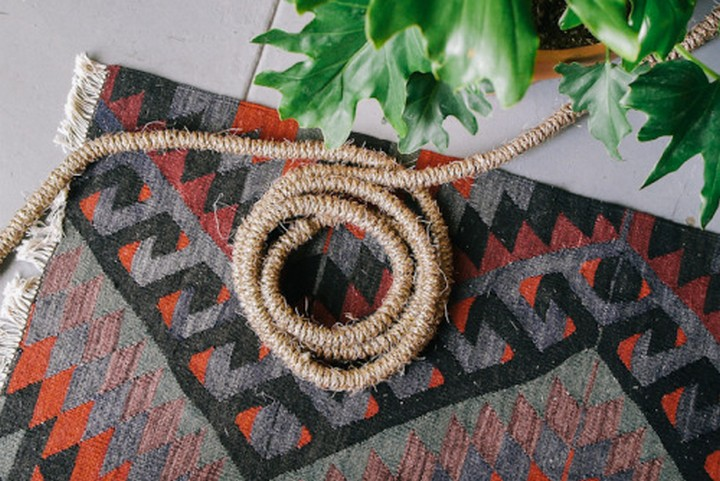 11 Creative Ways to Hide TV Wires - Make a design statement by wrapping your electrical cords with jute rope.