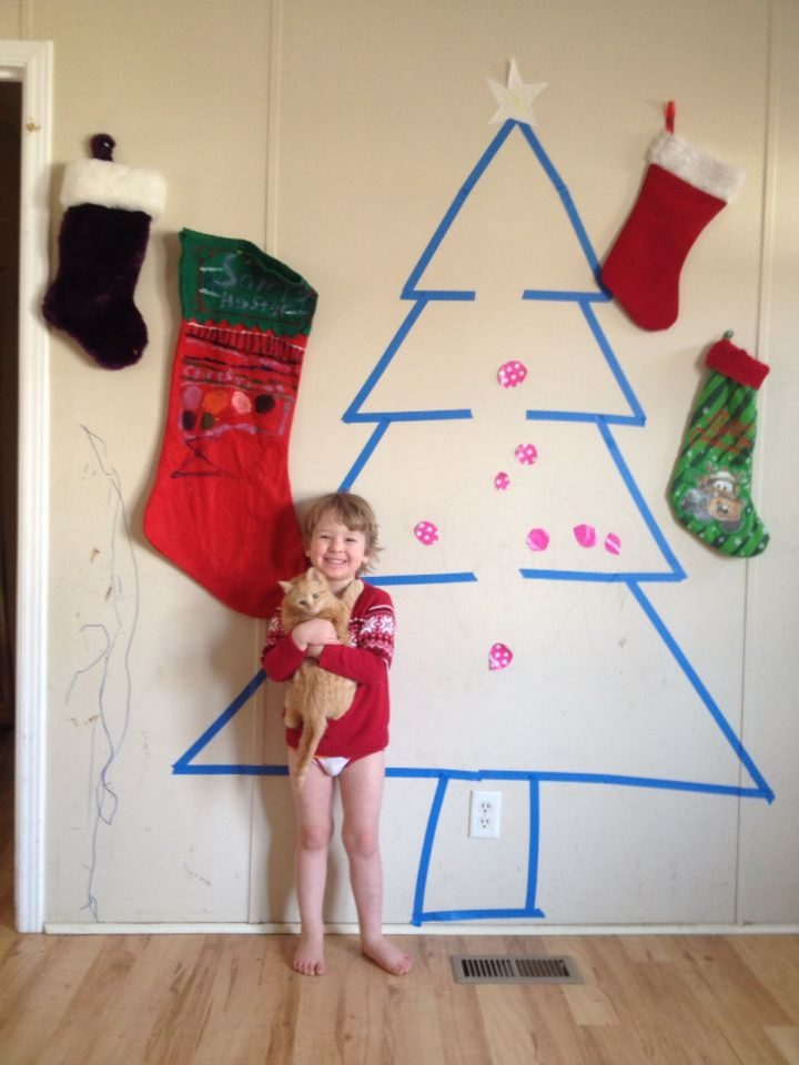 27 Lazy Christmas Decoration Ideas - Painter's tape makes the perfect Christmas tree.