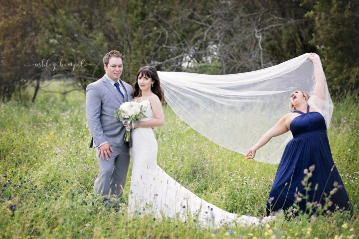 Wedding photographer Ashley Hempel asked Sharilyn Wester to help with the maid of honor duties such as the veil toss. She delivered in the most hilarious way possible!