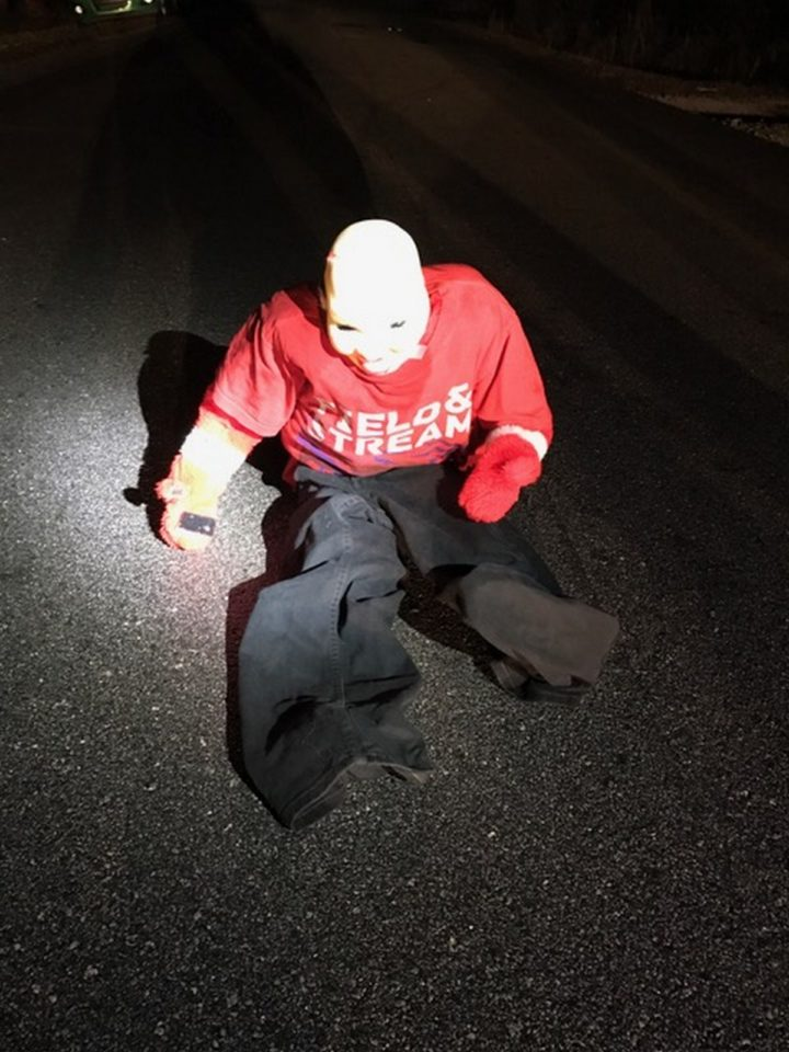 Thieves Set up Dummies in Kid's Clothing Sitting in the Middle of the Road.
